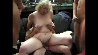 A Group of Guys Fuck the Horny Blond Female in Orgy